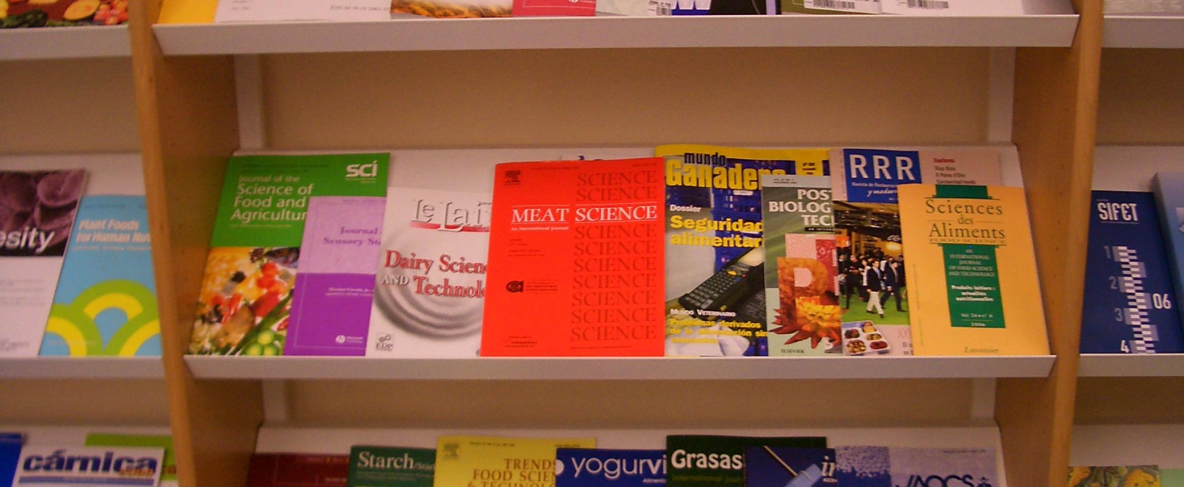 Science journals on bookshelf