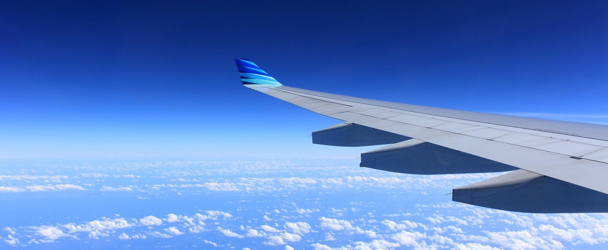 A photo of a airplane wing during a flight