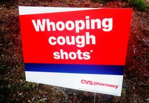 """Whooping cough shots"" sign"