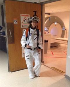 Julie Brefczynski-Lewis with AMPET helmet