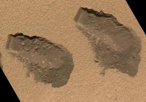 Not footprints on Mars; trenches dug by Curiosity's tiny sampling scoop. Credit:NASA/JPL-Caltech/MSSS