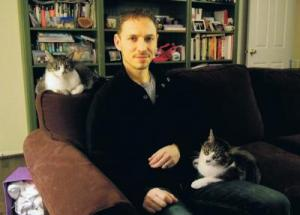 David Grimm, with Jasper on his lap, and Jezebel