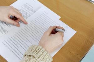 Editor correcting manuscript