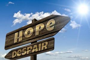 "Road signs ""hope"" and ""despair"""