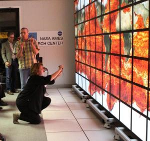 Christopher E. Henze demonstrates the analytical and visualization capabilities of the 128-screen Hyperwall.