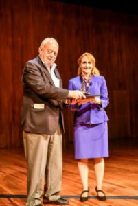 CASW executive director emeritus Ben Patrusky presents Jo Handelsman with an engraved crystal prism commemorating her Patrusky Lecture.