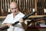 Gun dealer image via Shutterstock