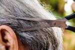 Cutting gray hair image via Shutterstock