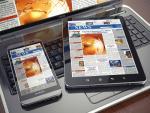 News readers image via Shutterstock
