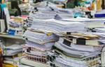 Document stacks image via Shutterstock