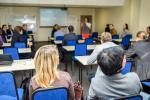 Conference room audience image via Shutterstock
